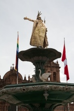 A golden statue of an Inca king sits proudly in the middle of the main square